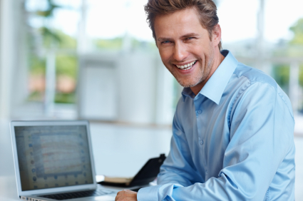 guy smiling with laptop iStock 000017470734XSmall