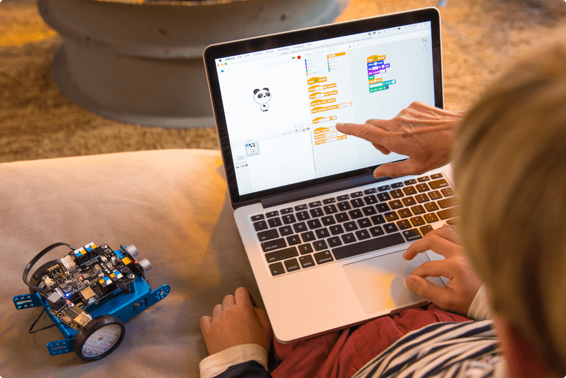 mbot scratch coding with laptop